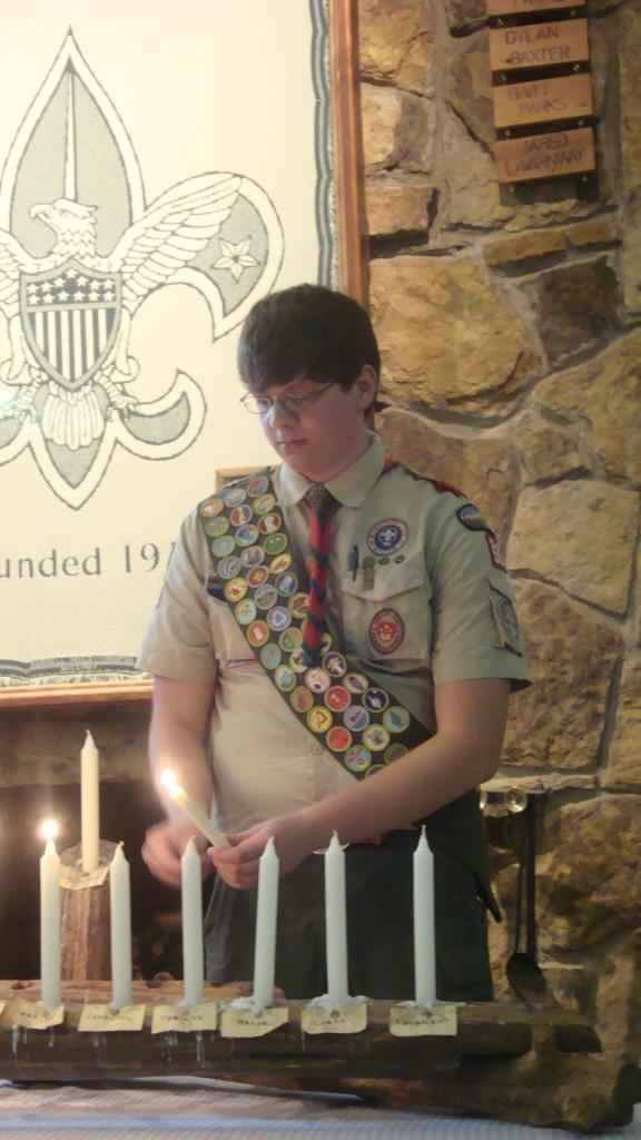 Senior+Matt+Gresham+lights+a+candle+during+the+Eagle+Scout+ceremony+on+August+31.+Gresham+received+41+merit+badges+as+a+Boy+Scout%2C+and+completed+his+Eagle+Scout+project+by+building+a+large+fence%2C+picnic+tables+and+benches+for+his+church.