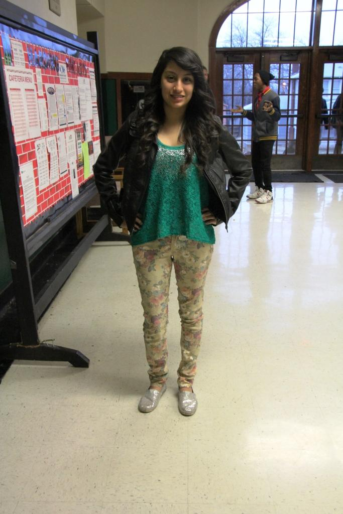 Freshman Heidi Rivera models her 90s-inspired floral skinny pants with a flowing tank and leather jacket.
