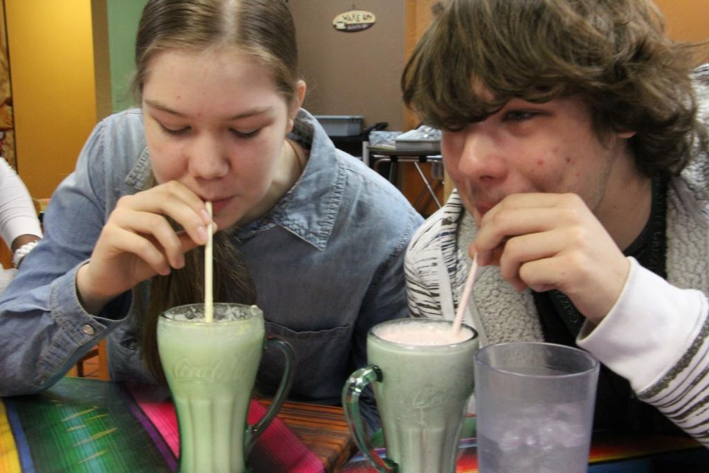 Marionette staffers Callie Struby and Michael Emerson enjoy Licuados, a fruit smoothie offered up by the chefs at Cafe Kacao.