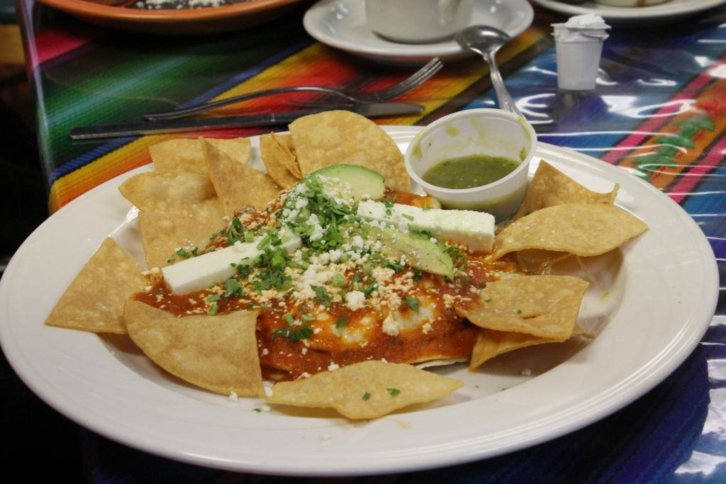 Motuleno is corn tortillas stuffed with black beans, topped with eggs cooked to order. A mild red sauce, dry cheese and avocados top the meal along with tortilla chips.