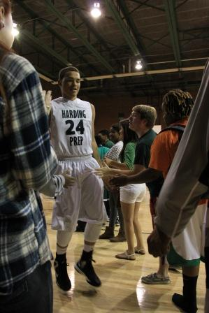 Senior Trey-Von Childs is greeted at the beginning of the HCP vs. Dove Tulsa game.