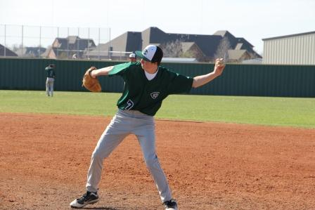Sophomore Carus Newman warms up to pitch against the CCS Eagles. The HCP Eagles lost the game 5-4.