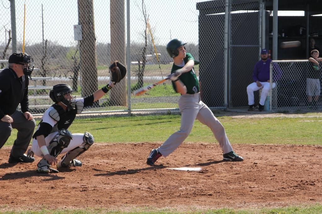 Sophomore Kyle Davis swings in the first inning in the game against Christian Community School on April 12.