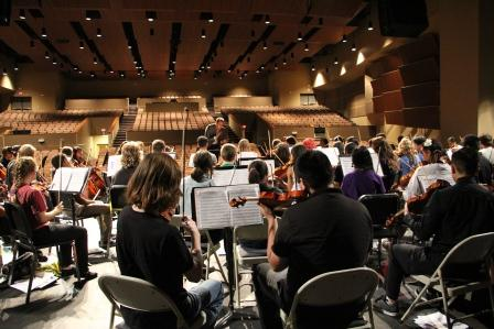 Members of the Oklahoma City All-City Orchestra rehearse with conductor Josh Klossner at Northwest Classen High School. Students from all over the city combined their talents to put on a concert that featured works by Beethoven, Rossini and Bach.