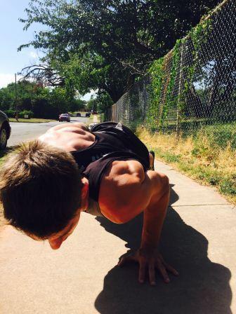 William Mlekush does one handed push-ups at calisthenics club