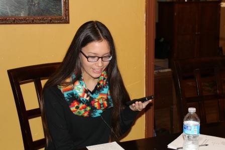 Freshman Bella Cornell records her radio show using her smartphone.