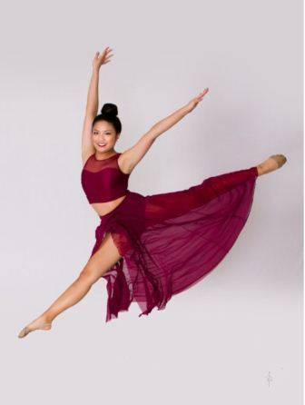 Taryn Nguyen is shown above posing midair.
