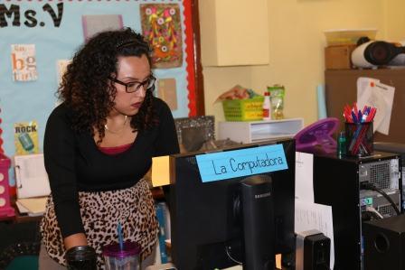 Liha Villanueva prepares to give oral exam to students.