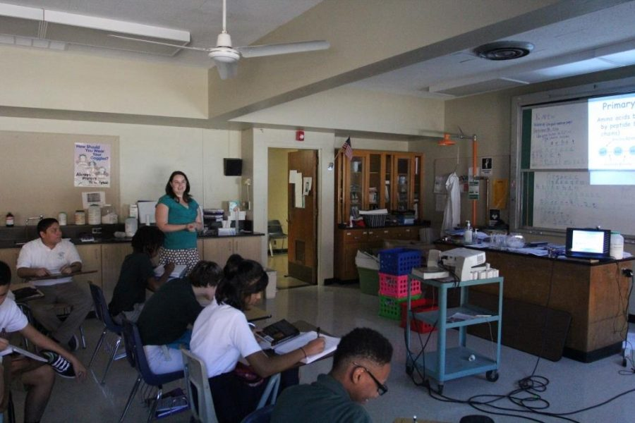 Science teacher Rachel Cox answers questions posed by her sophomore biology class.