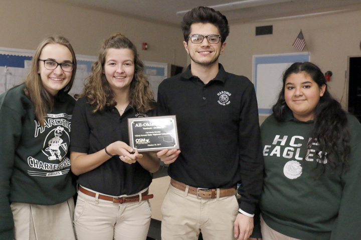 Madison Ellis, Karissa Henning, Arian Farkhoy and Janeth Rivera show off their All-Oklahoman plaque from the Oklahoma Scholastic Media, which they won for their work on the 2017 Aquila yearbook.