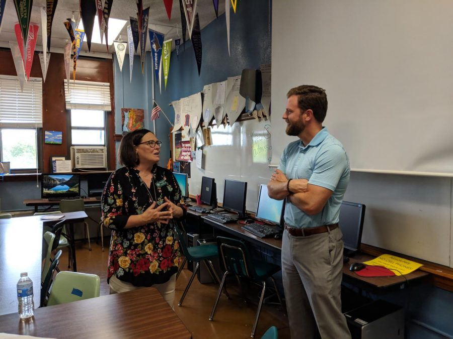 Rep. Jason Dunnington visits with AVID instructor Margaret Hensley during his visit on Sept. 5.