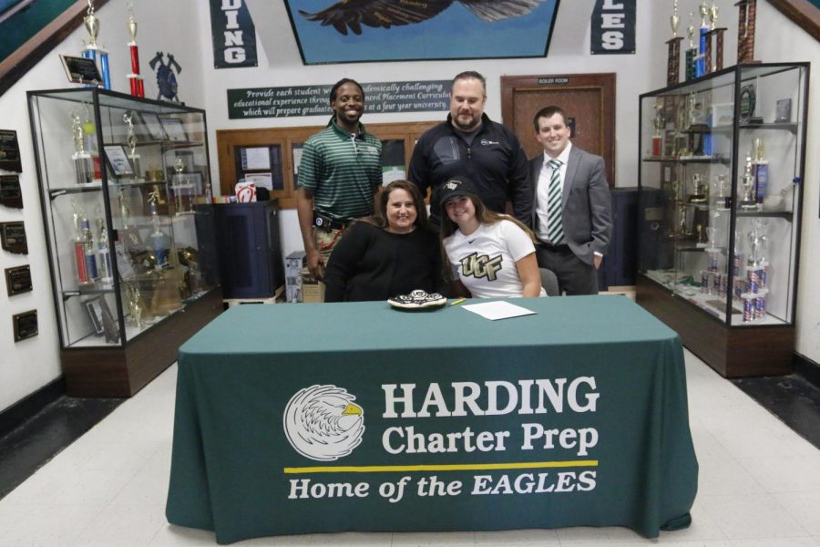 Lexi Wilson, center, signs with her chosen university.