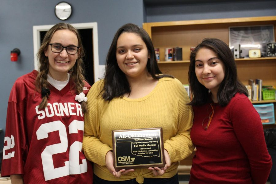 Seniors Madison Ellis, Litzy Soto and Yasmin Gramajo show off the Oklahoma Scholastic Media All-Oklahoman plaque they earned for their work on the 2018 Aquila yearbook.