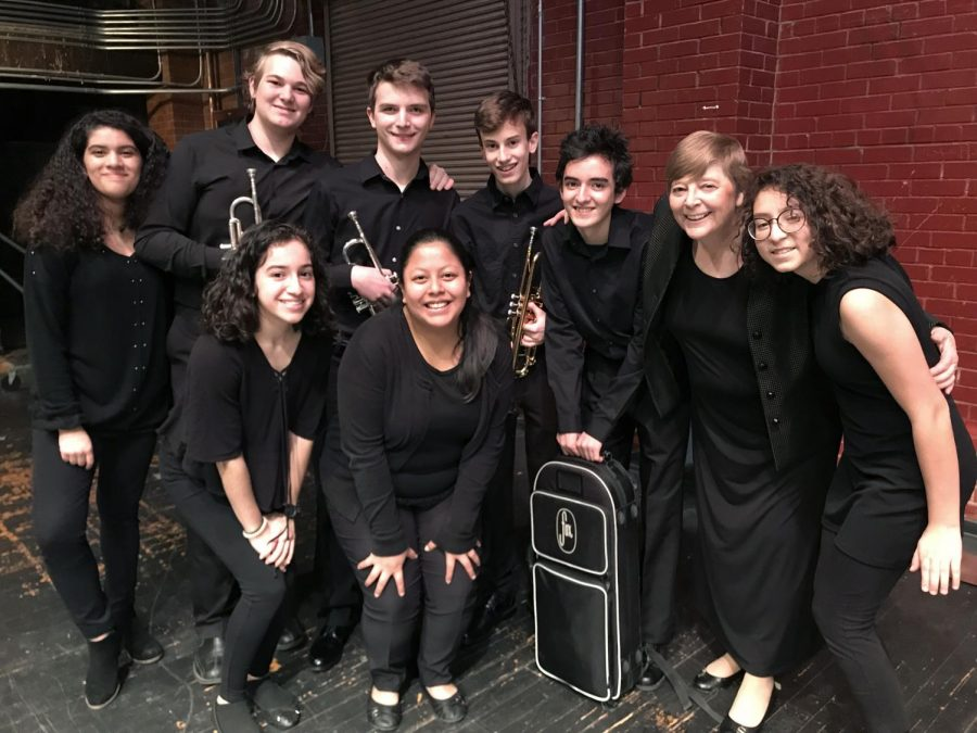 Members of the HCP band hang out with clinician Susan Clothier at the All City Clinic after their performance.