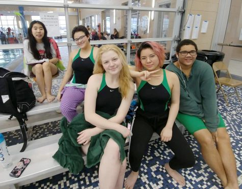 Swim team members Grace Ha, Isabella Vega, Faith Morrison, Reyna Sun and Alex Nadjkovic all take a breather while at the State swim meet.