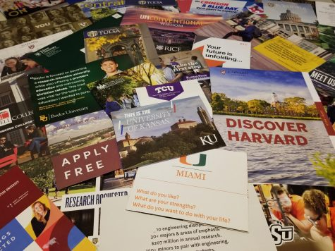 A large assortment of college brochures and letters from various different colleges and universities.