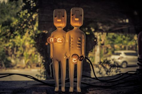 A beautiful photo of light installation art depicting two people.