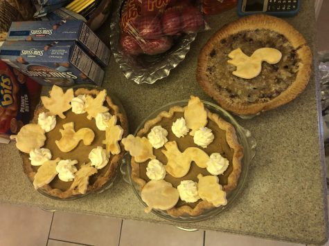 Two pumpkin pies baked by Anne Daniel and one cranberry pie.