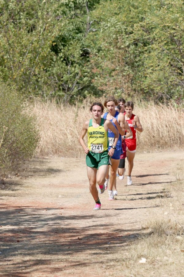 Senior Ryan McLaughlin leads the group during the first lap of the Edmond Santa Fe pre-state cross country meet on Sept. 25. McLaughlin later set a personal record and school record of 16.14 at the Chili Pepper festival in early October.