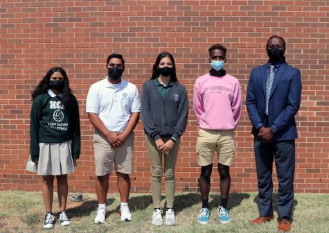 Junior Jocelyn Ramirez, sophomore Ronald Alvarado, freshman Meha Joseph and senior Emanuyel Brown, pictured with Principal Joe Hughes, were recognized as the September Awesome Eagles.