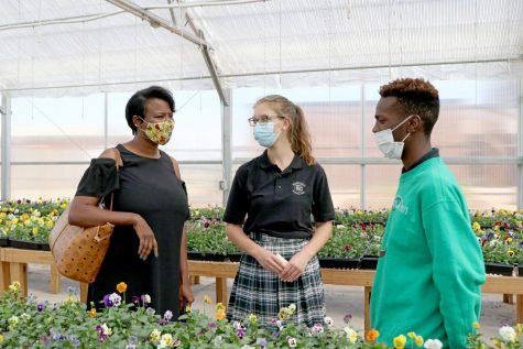 Councilwoman Nikki Nice asks seniors Anna Boevers and Emanuyel Brown questions about the greenhouse.