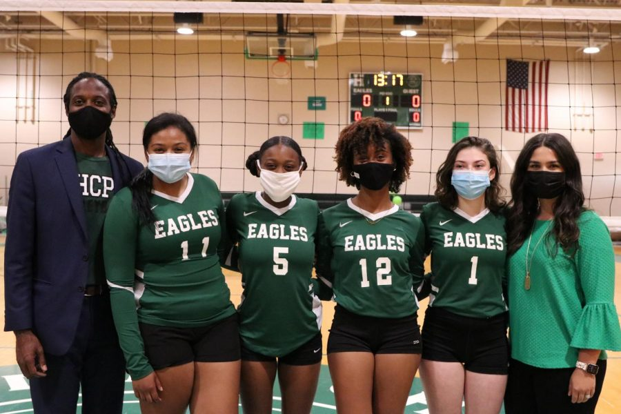 The senior volleyball team members pose with Principal Joe Hughes and coach Kendall Gomez for senior night.